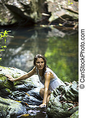 woman bathing in the stream - Beautiful young woman bathing...