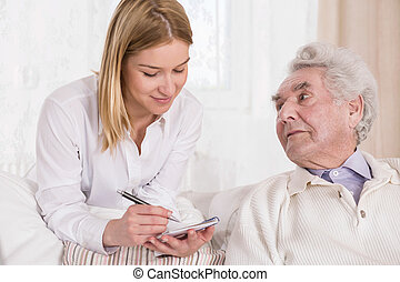 Elderly man with private carer