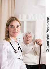 Doctor during home visit - Photo of female doctor during...