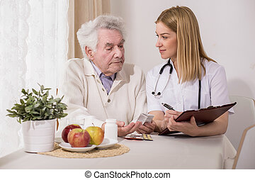 Physician writing healthcare program - Image of physician...