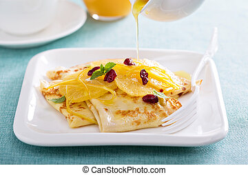 Thin crepes with citrus sauce and dried cranberry - Thin...