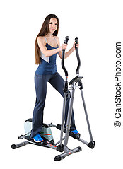young woman doing exercises on elliptical trainer - young...