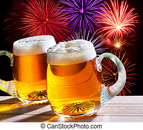 fireworks with two glasses of beer - two glasses of beer at...