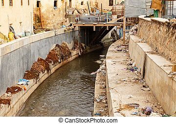 river in the city of FEZ, Morocco - the river flows in the...