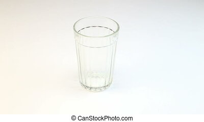 Faceted empty glass, video on white background