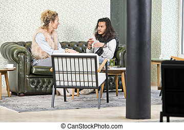 Personal conversation in a coffee corner - Man and woman...