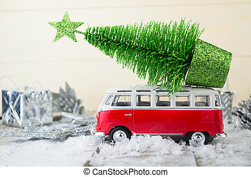 Miniature red car with fir tree