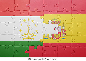 puzzle with the national flag of spain and tajikistan ....