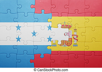 puzzle with the national flag of spain and honduras concept...