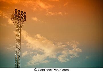Light stadium or Sports lighting against blue sky