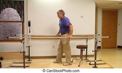 Parallel bars therapy - Man using Parallel Bars for walking...