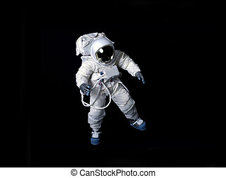 Astronaut floating in black space