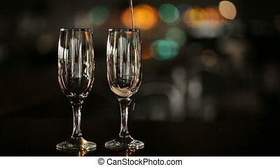 Champagne Pours in a Glass - Champagne pours in a glass at...