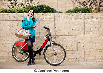 hire bike - happy young woman in the street with a hire bike