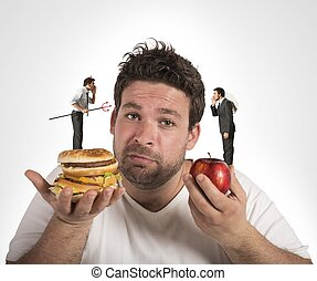 Diet guilty conscience - Man on diet with a guilty...