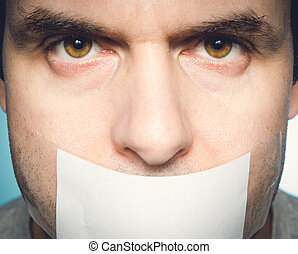 Caucasian man with duct tape on mouth, white . Conceptual...
