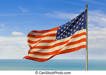 us flag against horizon over water