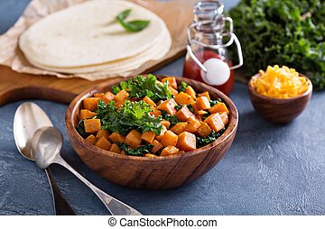Making quesadillas with kale and sweet potato - Making...