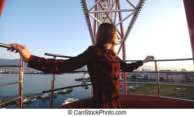 Tourism: pretty woman sightseeing city from height in the...
