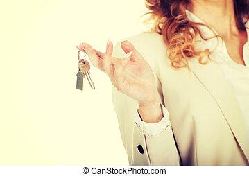Real estate agent giving keys.