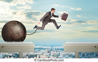 Image of young man jumping over gap - Image of young...