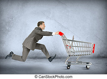 Businessman pushing empty shopping cart - Businessman...