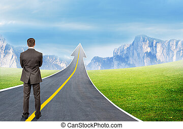 Man standing on highway road going up as arrow - Businessman...