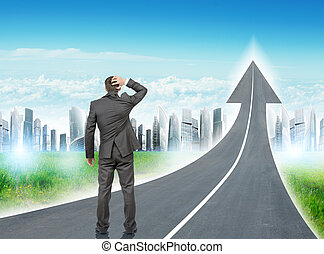 Man standing on freeway going up as arrow - Businessman...