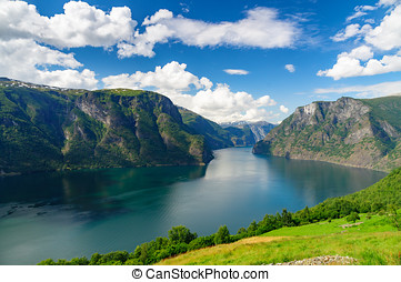 Aurlandsfjord against scenic blue sky, Norway -...