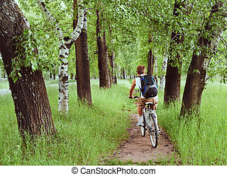 Man is riding a bicycle - Man with backpack is riding a...