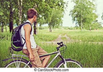 Hiking man on bicycle