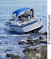Boat crash - Motorboat crash on rocky shore