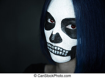 Woman with skull face art - Portrait of young woman with...