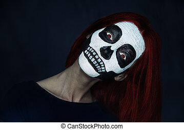Woman with skull face art - Portrait of surprised young...