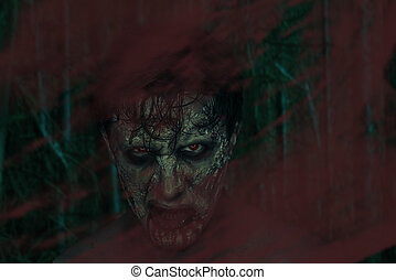 Horrible zombie man - Horrible zombie behind a bloody glass,...