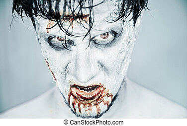 Zombie man in blood - Scary zombie man in blood on white...