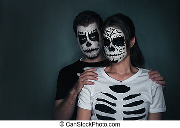Couple with sugar skull face art - Halloween loving couple...