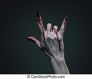 Bloody hand vampire - Vampire hand in blood on dark...