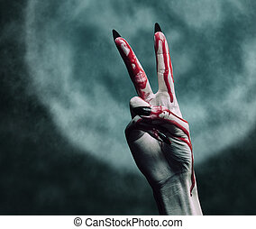 Halloween gesture peace sign - Vampire hand in blood on...