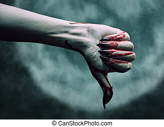 Vampire at midnight - Vampire hand in blood with thumb down...
