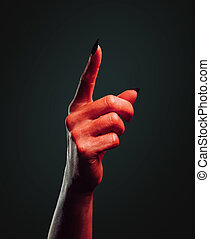 Demon hand pointing upward - Red demon hand with gesture...