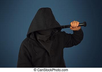 Hooligan with baseball bat - Hooligan man in hood and mask...