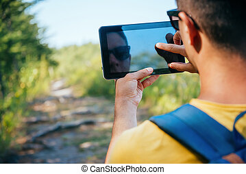 Traveler man with tablet PC