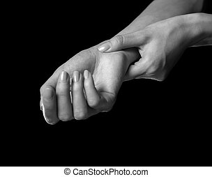 Carpal syndrome - Pain in a female wrist. Woman holds her...