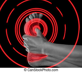 Pain foot of red color - Woman holds her foot, pain in the...