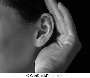 Human ear - Unrecognizable woman holds her hand near ear and...