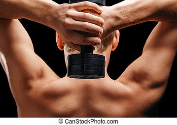 Sportsman holds dumbbell - Unrecognizable man holds...
