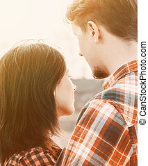 Couple in love, tranquil scene. With sunlight effect