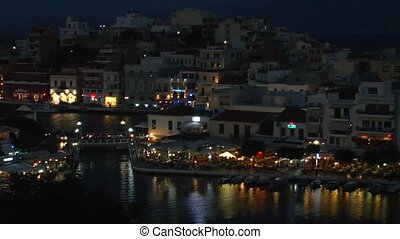 Agios Nikolaos city across the bay - Evening view of Agios...