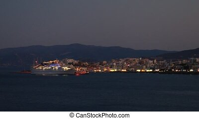 Evening view of Agios Nikolaos city across the bay Crete